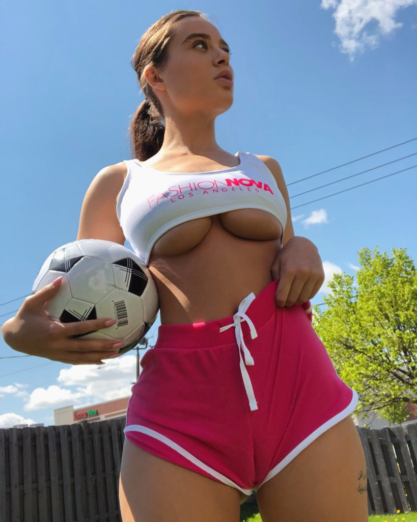 Teen girl showing underboob and ready to play ball
